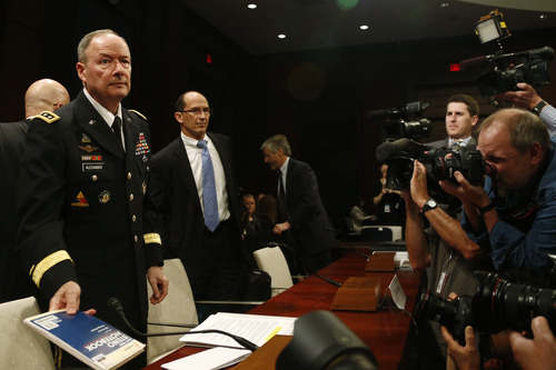 From left to right: Gen. Keith B. Alexander, director of the National Security Agency; Deputy Director of the FBI Sean Joyce, and Robert Litt, general counsel to the Office of the Director of National Intelligence; arrive to testify before the House Permanent Select Committee on Intelligence regarding NSA surveillance in Washington, Tuesday, June 18, 2013. (AP Photo/Charles Dharapak)