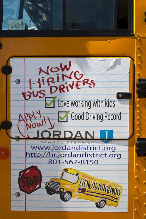 Chris Detrick  |  The Salt Lake Tribune A note written on the side of a Jordan School District bus by board member Corbin White Tuesday June 18, 2013.  A handwritten note on the advertisement was addressed to District Transportation Director Herb Jensen. It asked him to please get rid of that sign before the next scheduled parade in Riverton.