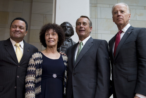 With the statue of statue of Frederick Douglass in the background, Nettie Washington Douglass, second from left, Frederick Douglass' great great granddaughter and her son Kenneth B. Morris, Jr., left, President of Frederick Douglass Family Initiatives (FDFI), House Speaker John Boehner of Ohio, second from right, and Vice President Joe Biden are photographed after ceremony to dedicate the statue, Wednesday, June 19, 2013, in the Emancipation Hall of the United States Visitor Center on Capitol Hill in Washington. The bronze statue of Douglass is by Maryland artist Steve Weitzman. (AP Photo/Carolyn Kaster)