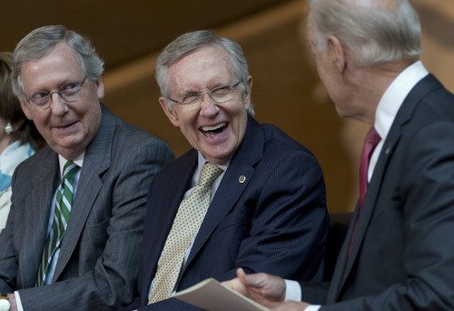 From left, Senate Minority Leader Mitch McConnell of Ky., and Senate Majority Leader Harry Reid of Nev., laugh with  Vice President Joe Biden during a ceremony to dedicate the statue of Frederick Douglass in the Emancipation Hall of the United States Visitor Center on Capitol Hill in Washington, Wednesday, June 19, 2013. (AP Photo/Carolyn Kaster)