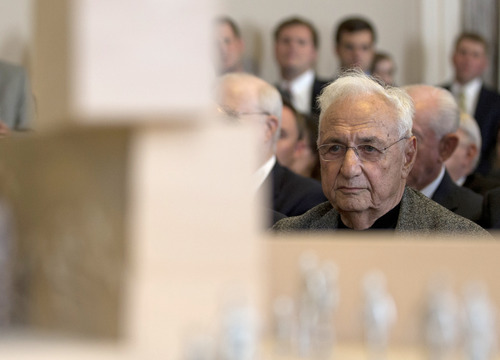 Architect Frank Gehry attends a public meeting of the Eisenhower Memorial Commission on Capitol Hill in Washington, Wednesday, June 19, 2013, to discuss the continued controversy over his design for a memorial honoring Dwight D. Eisenhower. Gehry is changing some elements of his design for a memorial honoring President Dwight D. Eisenhower in Washington as memorial planners move toward seeking approvals to build the project. A model of the memorial is seen in the foreground. (AP Photo/Carolyn Kaster)