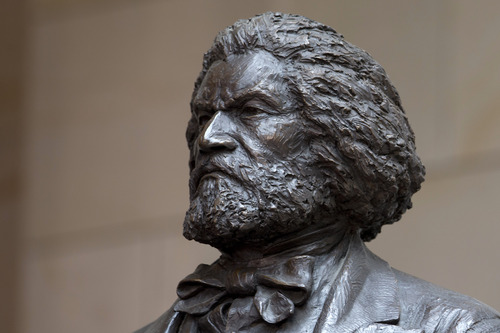 A bronze statue of 19th-century orator and writer Frederick Douglass is seen in the Emancipation Hall of the United States Visitor Center on Capitol Hill in Washington, Wednesday, June 19, 2013, where it was dedicated. The bronze statue of Douglass is by Maryland artist Steve Weitzman. (AP Photo/Carolyn Kaster)