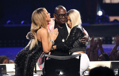 "Judges Mariah Carey, left, and Nicki Minaj, right, kiss Randy Jackson following a tribute to Jackson at the ""American Idol"" finale at the Nokia Theatre at L.A. Live on Thursday, May 16, 2013, in Los Angeles. (Photo by Matt Sayles/Invision/AP)"
