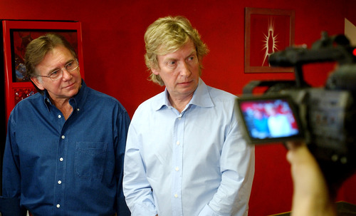 """FILE - This March 15, 2005 file photo shows """"American Idol"""" producers Ken Warwick, left, and Nigel Lythgoe during a news conference in Los Angeles. Fox said Sunday, June 9, 2013, that longtime executive producers Nigel Lythgoe and Ken Warwick are exiting the singing contest. Its 12th season ended in May with a record low-rated finale. The producers follow judges Mariah Carey, Nicki Minaj and Randy Jackson out the door. Fox confirmed the producers' departure after Lythgoe said online that he'd been """"fired"""" from the show. (AP Photo/Rene Macura, file)"""