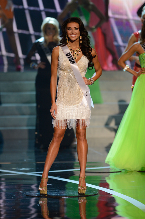Miss Utah Marissa Powell walks the runway during the introductions of the Miss USA 2013 pageant, Sunday, June 16, 2013, in Las Vegas. (AP Photo/Jeff Bottari)