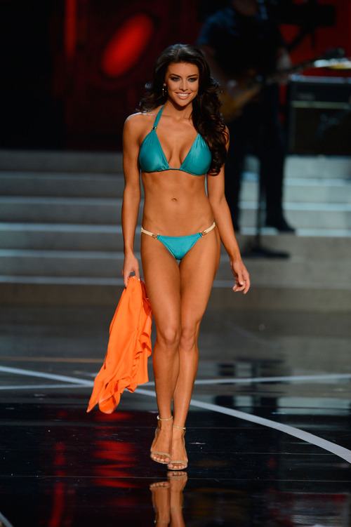 Miss Utah Marissa Powell walks the runway during the swimsuit competition of the Miss USA 2013 pageant, Sunday, June 16, 2013, in Las Vegas. (AP Photo/Jeff Bottari)