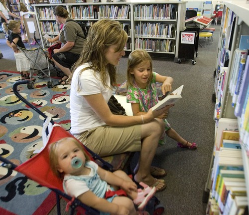 Paul Fraughton  |  The Salt Lake Tribune In the children's area of the Weber County Library, Jamie Abney reads books to her daughters Lucy, age 1, and  Abigail, age 4.        Tuesday, June 18, 2013