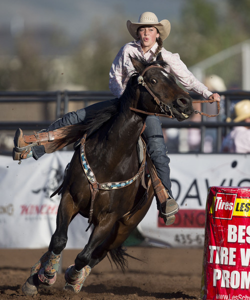 Lennie Mahler  |  The Salt Lake Tribune Alexis Smith of Lehi scores a 17.129 in the barrel racing event in the Utah High School Rodeo Championships in Heber City, Utah, Friday, June 14, 2013.