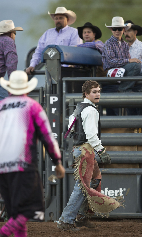 Lennie Mahler  |  The Salt Lake Tribune Dakota Ogden scores a 74 in bull riding to win the event in the Utah High School Rodeo Championships in Heber City, Utah, Friday, June 14, 2013.