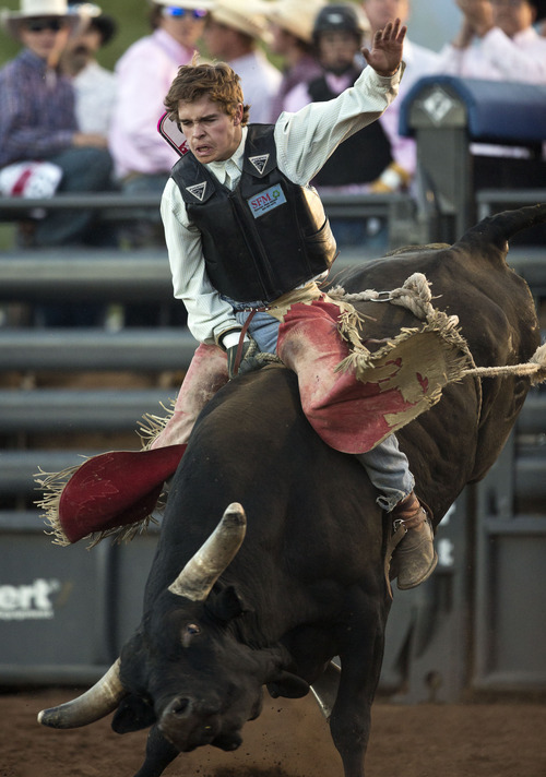 Lennie Mahler  |  The Salt Lake Tribune Dakota Ogden scores a 74 in bull riding to win the event in the Utah High School Rodeo Championships in Heber City, Utah, Friday, June 14, 2013.