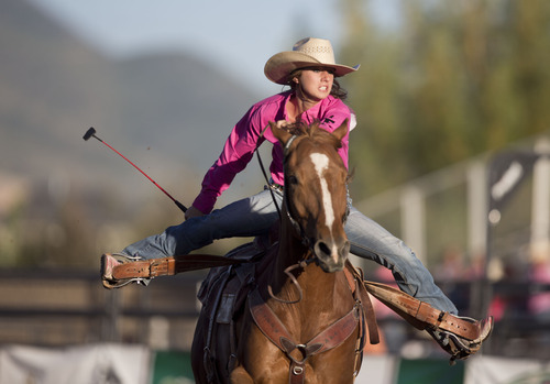Lennie Mahler  |  The Salt Lake Tribune Lily Friar competes in the barrel racing event in the Utah High School Rodeo Championships in Heber City, Utah, Friday, June 14, 2013.