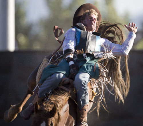 Lennie Mahler  |  The Salt Lake Tribune Colton Turner of Dixie scores a 52 in saddle bronc riding to win the event in the Utah High School Rodeo Championships in Heber City, Utah, Friday, June 14, 2013.
