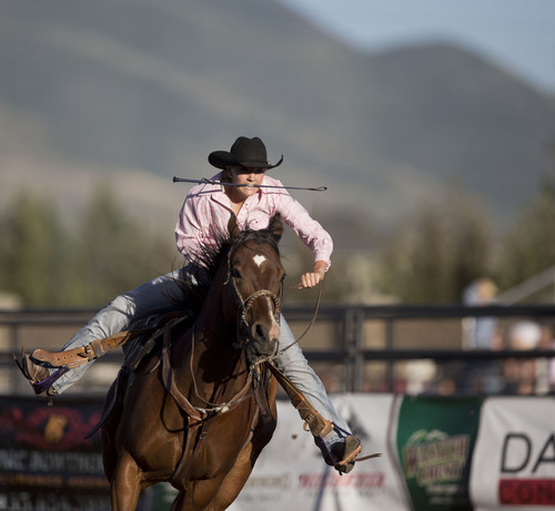 Lennie Mahler  |  The Salt Lake Tribune Taylor Rogers scores a 17.437 in the barrel racing event in the Utah High School Rodeo Championships in Heber City, Utah, Friday, June 14, 2013.