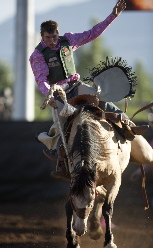 Lennie Mahler  |  The Salt Lake Tribune Alex Wright of Sanpete competes in saddle bronc riding in the Utah High School Rodeo Championships in Heber City, Utah, Friday, June 14, 2013.