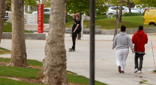 Trent Nelson  |  Tribune file photo A skateboarder glides through the University of Utah campus in Salt Lake City. A new plan approved Monday would subject skateboarders and bikers to new rules and safety warnings, but wouldn't kick them off campus.