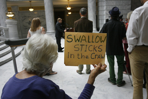 Scott Sommerdorf   |  The Salt Lake Tribune Naomi Franklin of the League of Women Voters holds up a sign describing her views at a rally in the Capitol Rotunda showing solidarity to protest alleged corruption in the attorney general's office as House Republicans meet to discuss possible impeachment proceedings against John Swallow, Wednesday, June 19, 2013.