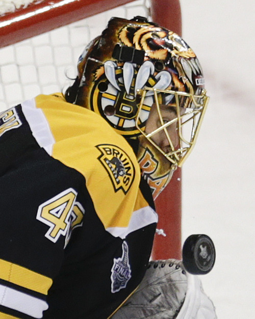 Boston Bruins goalie Tuukka Rask (40), of Finland, turns aside the puck against the Chicago Blackhawks during the first period in Game 4 of the NHL hockey Stanley Cup Finals, Wednesday, June 19, 2013, in Boston. (AP Photo/Charles Krupa)