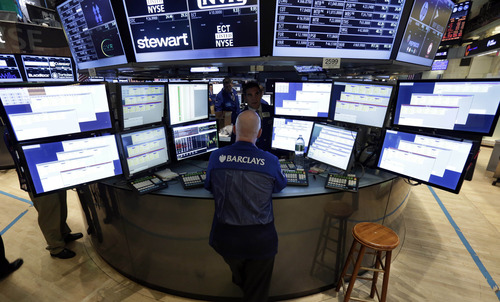 Specialist John O'Hara works at his post on the floor of the New York Stock Exchange, Thursday, June 20, 2013. Financial markets are sliding after the Federal Reserve said it could end its huge bond-buying program by the middle of next year. (AP Photo/Richard Drew)