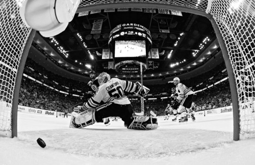 Boston Bruins right wing Nathan Horton, left, watches a shot by Bruins defenseman Johnny Boychuk, not seen, cross the goal line behind Chicago Blackhawks goalie Corey Crawford (50) during the third period in Game 4 of the NHL hockey Stanley Cup Finals Wednesday, June 19, 2013, in Boston. Watching, at right, is Chicago Blackhawks defenseman Niklas Hjalmarsson (4), of Sweden. Chicago won 6-5 to even the series 2-2. (AP Photo/Harry How, Pool)