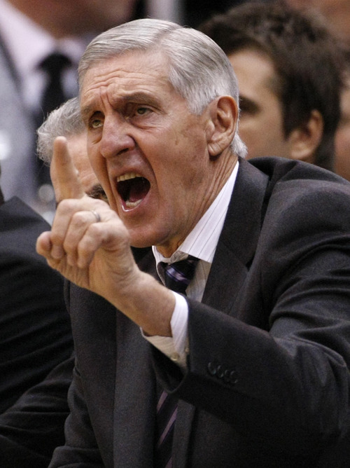 This Dec. 3, 2010, file photo shows Utah Jazz coach Jerry Sloan during the first half of an NBA basketball game against the Dallas Mavericks,  in Salt Lake City. Sloan stepped down as head coach of the Jazz on Thursday. (AP Photo/Colin E Braley, File)