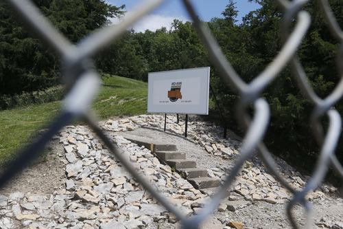 A fence helps guard the entrance to the Vivos Shelter and Resort which is part of the Mo/Kan Underground facility in Atchison, Kan., Tuesday, June 18, 2013. (AP Photo/Orlin Wagner)