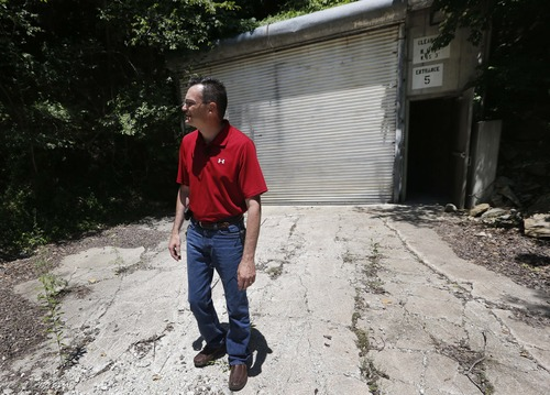 Coby Cullins stands next to an entrance to the Vivos Shelter and Resort during a tour of the facility in Atchison, Kan., Tuesday, June 18, 2013. (AP Photo/Orlin Wagner)