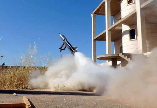 FILE - In this Tuesday, June 4, 2013 file photo citizen journalism image provided by Edlib News Network, ENN, which has been authenticated based on its contents and other AP reporting, shows a locally made rocket being fired by Syrian rebels, in Idlib province, northern Syria. Syria's rebels have received shipments of more powerful weapons from Gulf allies, particularly anti-tank and anti-aircraft missiles, that have already helped stall advances by regime forces. The shipments have also sparked feuding and sniping between rebel factions, illustrating the tangles the United States faces as it prepares to start directly arming a rebellion riven by rivalries and competitions and dominated by Islamist radicals. (AP Photo/Edlib News Network ENN, File)