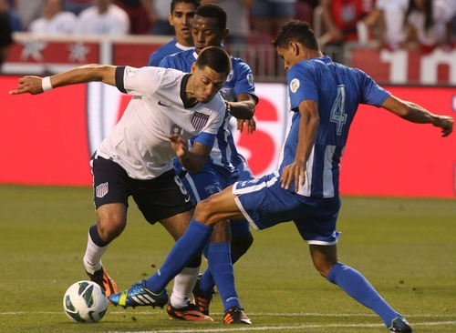 Leah Hogsten  |  The Salt Lake Tribune Clint Dempsey (8) of the U.S. tries to round Honduras' Juan Pablo Montes (4). USA defeated Honduras 1-0 at the half during their World Cup soccer qualifying rematch Tuesday, June 18, 2013 at Rio Tinto Stadium.