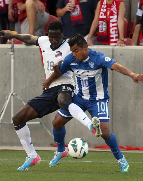 Leah Hogsten  |  The Salt Lake Tribune Eddie Johnson (18) of the U.S. and Honduras' Mario Martinez (10) battle for possession. USA defeated Honduras 1-0 at the half during their World Cup soccer qualifying rematch Tuesday, June 18, 2013 at Rio Tinto Stadium.