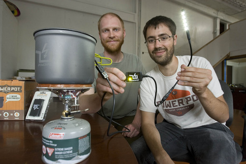 Paul Fraughton  |  The Salt Lake Tribune Paul Slusser and David Toledo show off their invention, The PowerPot, that can create power to run small electrical devices transforming the energy from heating water.                             Tuesday, May 28, 2013