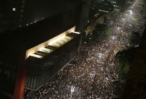 Crowds gather along Paulista Avenue to celebrate the reversal of a fare hike on public transportation after days of protest in Sao Paulo, Brazil, Thursday, June 20, 2013. Protesters gathered for a new wave of massive demonstrations in Brazil on Thursday, extending the protests that have sent hundreds of thousands of people into the streets since last week to denounce poor public services and government corruption. (AP Photo/Nelson Antoine)