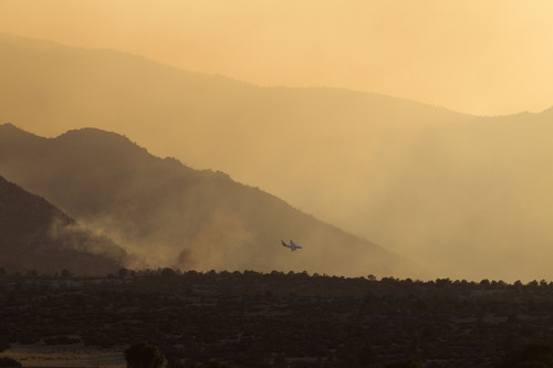 An air tanker prepares to drop its load of retardant on the Doce Fire on Wednesday, June 19, 2013 in the hills northwest of Prescott, AZ. The fire has burned 7,000 acres and 460 homes have been evacuated. (AP Photo/The Arizona Republic, Rob Schumacher)