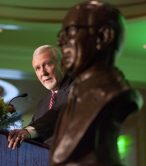 Steve Griffin | The Salt Lake Tribune With the bust of Associated Food Stores Inc. founder, Donald P. Lloyd in the foreground, Associated Food Stores CEO, Neal Berube, speaks during the company's annual meeting at the Little America hotel in  Salt Lake City, Utah Friday June 21, 2013.
