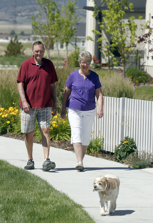 Al Hartmann  |  The Salt Lake Tribune Ed and Carol Simpson walk home to their patio home with their dog Sara at Daybreak's Garden Park neighborhood which targets the 55 years and over set.   They like the the walkability, neighbors and maintenance-free yards.  Where to Retire magazine just named Daybreak as a top 50 master-planned community. The listing cited Daybreak's fishing lake and energy efficient homes as attractive amenities to retirees.