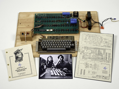 "Christies Images Ltd. 2013  |  The Associated Press This undated photo provided by Christie's Auction House shows an ""Apple 1"" prototype computer, built in 1976, accompanied by an operation manual and schematic as well as a photo of its inventors, Steve Wozniak, left, and Steve Jobs. One of the very first Apple 1 computers, it goes on sale later this month at Christie's auction house, the latest in a recent run of vintage tech sales that have attracted some eye-popping prices."