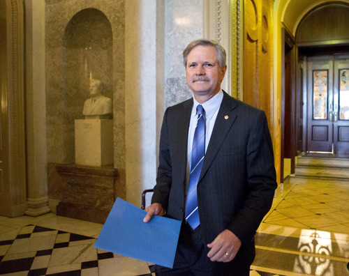 Sen. John Hoeven, N.D., leaves the Senate chamber after speaking on his amendment to the immigration reform bill, at the Capitol in Washington, Friday, June 21, 2013. Hoeven and Sen. Bob Corker, R-Tenn., are pushing an amendment that insists on increased border security with an increase in Border Patrol agents and unmanned surveillance drones. (AP Photo/J. Scott Applewhite)