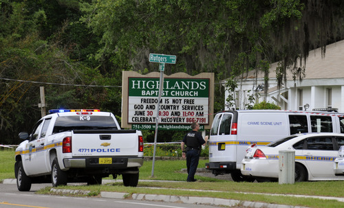 Police gather at the Highlands Baptist Church in Jacksonville, Fla. on Saturday, June 22, 2013 where authorities said the body of 8-year-old Charish Perriwinkle was found. An Amber Alert was issued after she went missing Friday night, but authorities began a murder investigation after her body was found at the church. (AP Photo/The Florida Times-Union, Will Dickey)