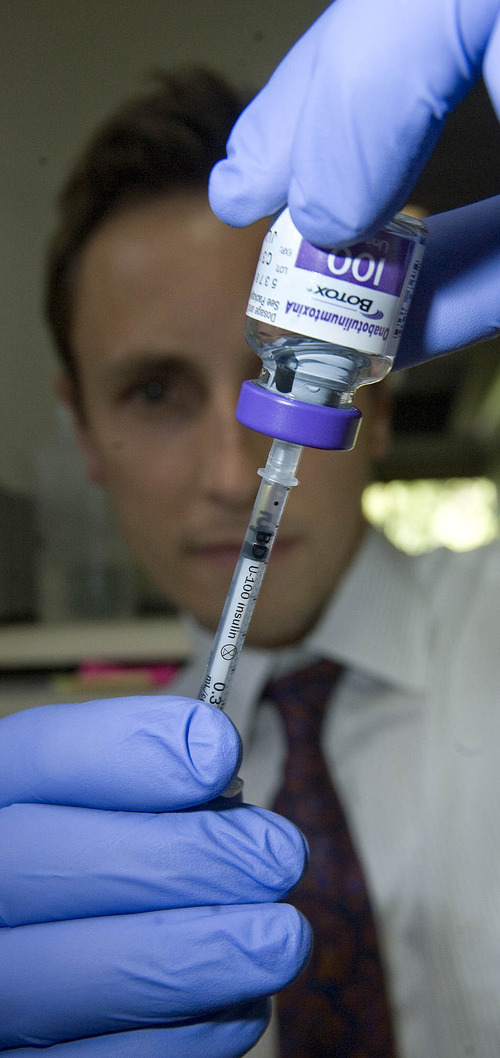 Paul Fraughton  |   Salt Lake Tribune  Dr. Jordan Davis DDS   loads a syringe of botox.                           Wednesday, June 19, 2013