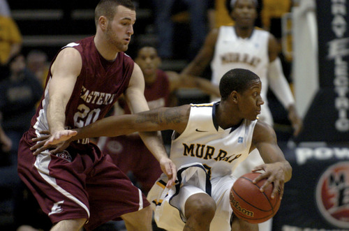 Eastern Kentucky's Jeff Allgood (20) pressures Murray State's Isaiah Canaan in the first half of an NCAA college basketball game on Wednesday, Jan. 4, 2012, in Murray, Ky. (AP Photo/Stephen Lance Dennee)