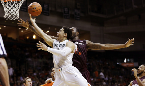 Miami's Shane Larkin (0) shoots past Virginia Tech's Cadarian Raines (4) during the second half of an NCAA college basketball game in Coral Gables, Fla., Wednesday, Feb. 27, 2013. Miami won 76-58. (AP Photo/J Pat Carter)