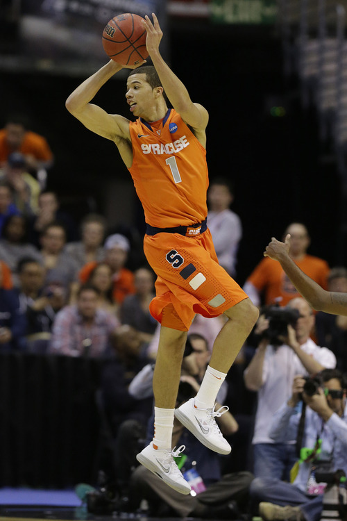 Syracuse guard Michael Carter-Williams (1) passes the ball during the second half of the East Regional final in the NCAA men's college basketball tournament, Saturday, March 30, 2013 in Washington. (AP Photo/Alex Brandon)