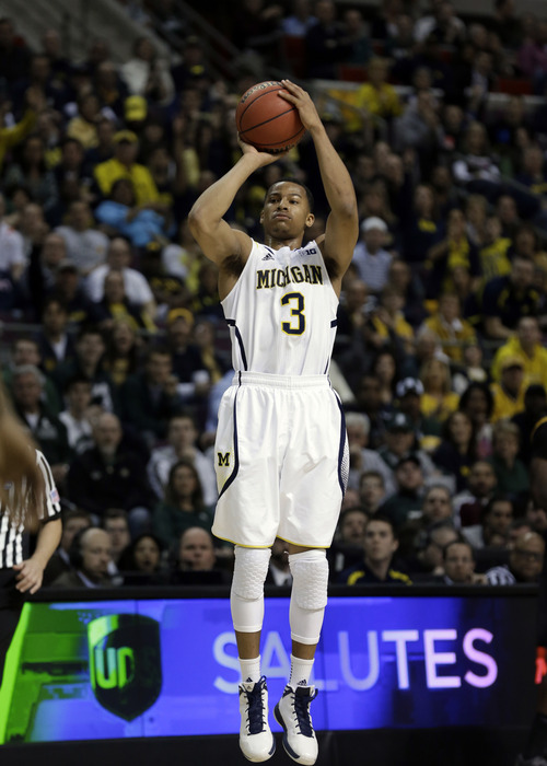 Michigan guard Trey Burke (3) shoots against Virginia Commonwealth in their third-round game of the NCAA college basketball tournament in Auburn Hills, Mich., Saturday March 23, 2013. (AP Photo/Paul Sancya)