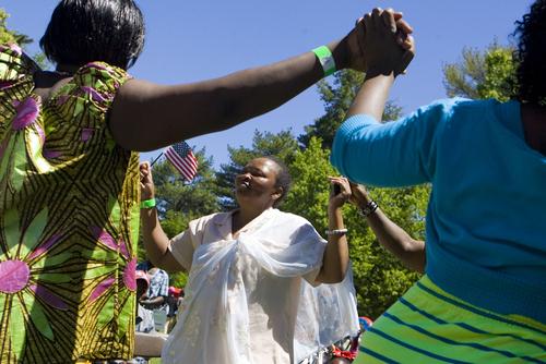 Keith Johnson  |  The Salt Lake Tribune Uwimeza Anociate, center, dances during World Refugee Day at Liberty Park in Salt Lake City, June 22, 2013.