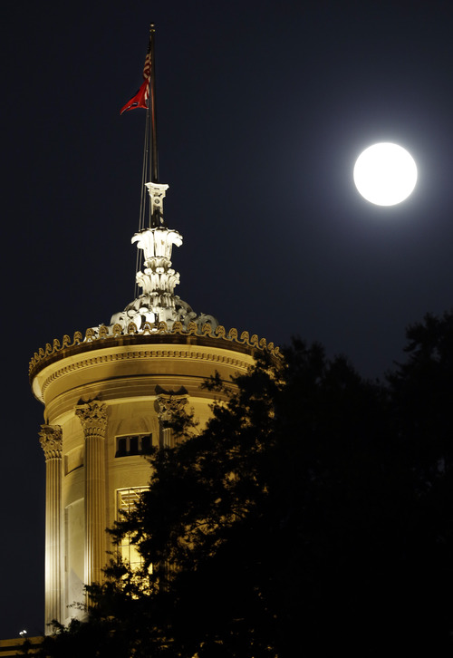The moon rises behind the Tennessee state capitol on Saturday, June 22, 2013, in Nashville, Tenn. The biggest and brightest full moon of the year, called a supermoon, happens as the moon passes closer to earth than usual. (AP Photo/Mark Humphrey)