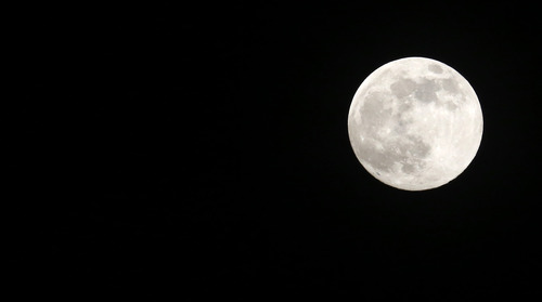 A full moon rises over Jackson, Miss., Saturday, June 22, 2013. The moon, which will reach its full stage on Sunday, is expected to be significantly closer to earth during a phenomenon known as supermoon. (AP Photo/Rogelio V. Solis)