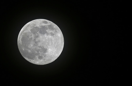 A full moon rises over Miami, Saturday, June 22, 2013. The moon, which will reach its full stage on Sunday, is expected to be 13.5 percent closer to earth during a phenomenon known as supermoon. (AP Photo/Alan Diaz)