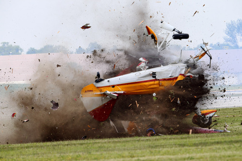 ED'S NOTE: GRAPHIC CONTENT - A stunt plane with a wing walker crashes during a performance at the Vectren Air Show, Saturday, June 22, 2013, in Dayton, Ohio. The crash killed the pilot and the wing walker instantly, authorities said. (AP Photo/Thanh V Tran) MANDATORY CREDIT DOMESTIC USE ONLY. FOR INTERNATIONAL USE CONTACT AP IMAGES