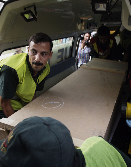 Pakistani rescue workers unload the casket of a foreign tourist who was killed by Islamic militants, from an ambulance to shift in a morgue of local hospital in Islamabad, Pakistan, Sunday, June 23, 2013. Islamic militants wearing police uniforms shot to death foreign tourists and at least one Pakistani before dawn as they were visiting one of the world's highest mountains in a remote area of northern Pakistan that has been largely peaceful, officials said. (AP Photo/Anjum Naveed)