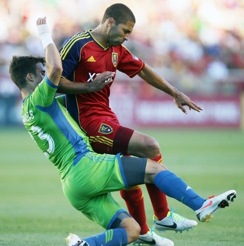 Kim Raff  |  The Salt Lake Tribune (right) Real Salt Lake forward Alvaro Saborio (15) and (left) Seattle Sounders FC midfielder Servando Carrasco (23) collide during the first half at Rio Tinto Stadium in Sandy on June 22, 2013. Real went on to win the game 2-0.