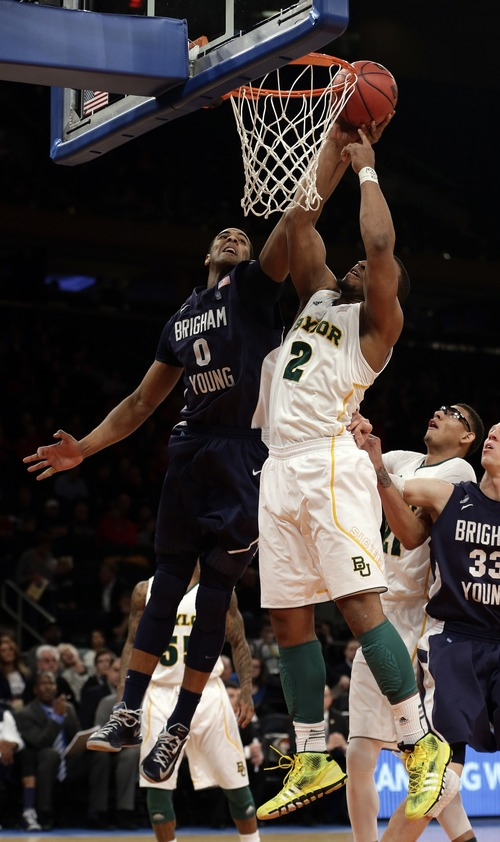 Brigham Young's Brandon Davies (0) is defended by Baylor's Rico Gathers (2) during the second half of an NIT semifinal basketball game Tuesday, April 2, 2013, in New York. (AP Photo/Frank Franklin)